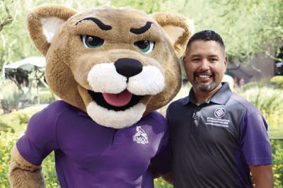 Rey Rivera with Roary the Estrella Mountain Lion