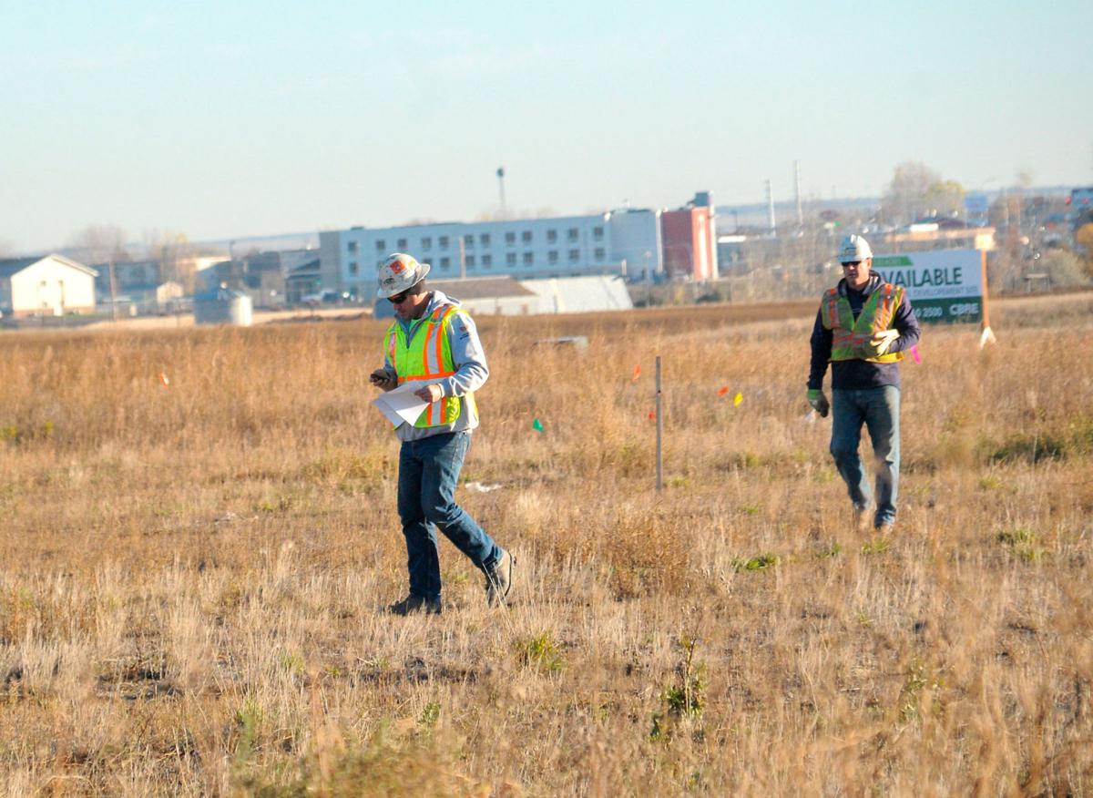 Workers from braun intertec lay out the property boundaries at the site of the new red rock ford dealership on 138th avenue northwest in williston