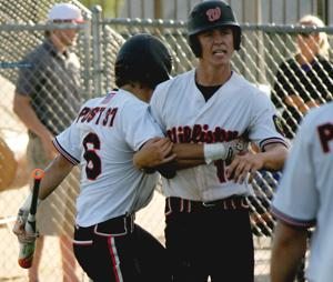 "<p class=""p1"">Matt Hickman • Williston Herald</p><p class=""p2""><span class=""s1""><strong>Williston Keybirds Corey Cayko is congratulated by teammate Bailey Zaste after scoring the winning run in the eighth inning of Thursday's game against the Fargo Post 400 Trappers. Today in Dickinson, the Keybirds open the North Dakota American Legion State Tournament at noon against West Fargo.</strong></span></p>"