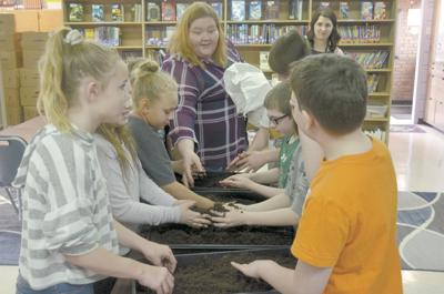 Elementary students learn a lesson in organic gardening