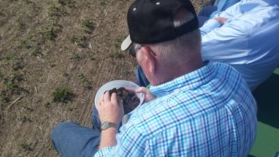drylands field days file photo farmer looking at soil