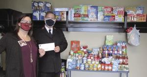 Western-Cooperative-Credit-Union-donates-to-Williston-Salvation-Army-Food-Pantry