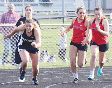 Winchester's Morgan Lawrence takes the handoff from Paige Weatherhead on Tuesday at Hagerstown
