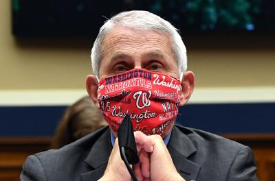 Dr. Anthony Fauci, director of the National Institute of Allergy and Infectious Diseases, wearing a Washington Nationals face mask to testify at a hearing of the U.S. House Committee on Energy and Commerce on Capitol Hill on June 23, 2020, in Washington, D.C.