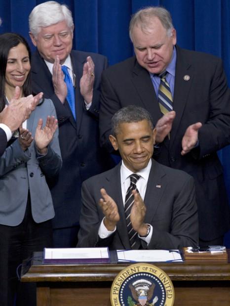Barack Obama,   Nancy E. Tate, Katherine McFate, Tim Walz, John Larson, Melanie Sloan, Joe Biden,