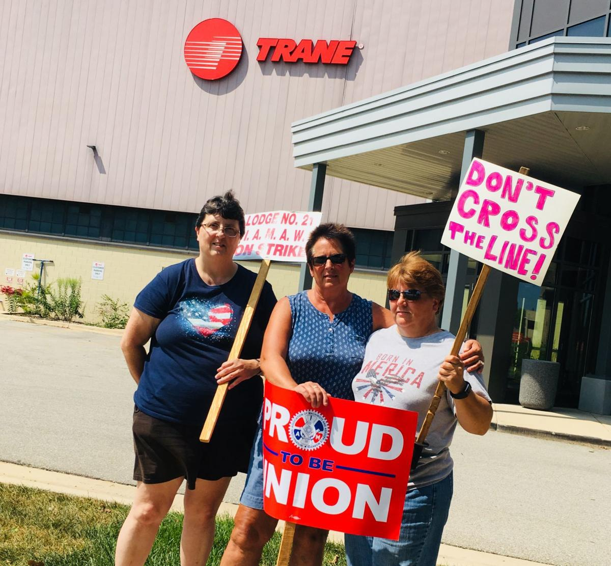Trane strikers cite pay, forced overtime as top issues as they picket  outside La Crosse employer