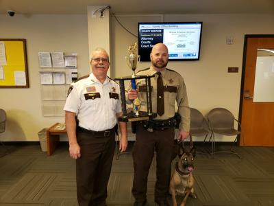 Sheriff Ron Ganrude, Deputy Adam Carlson and K9 Cleo