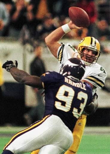 Minnesota Vikings defensive tackle John Randle sacks Green Bay Packers  quarterback Brett Favre in the third quarter Sunday 83499d8eb