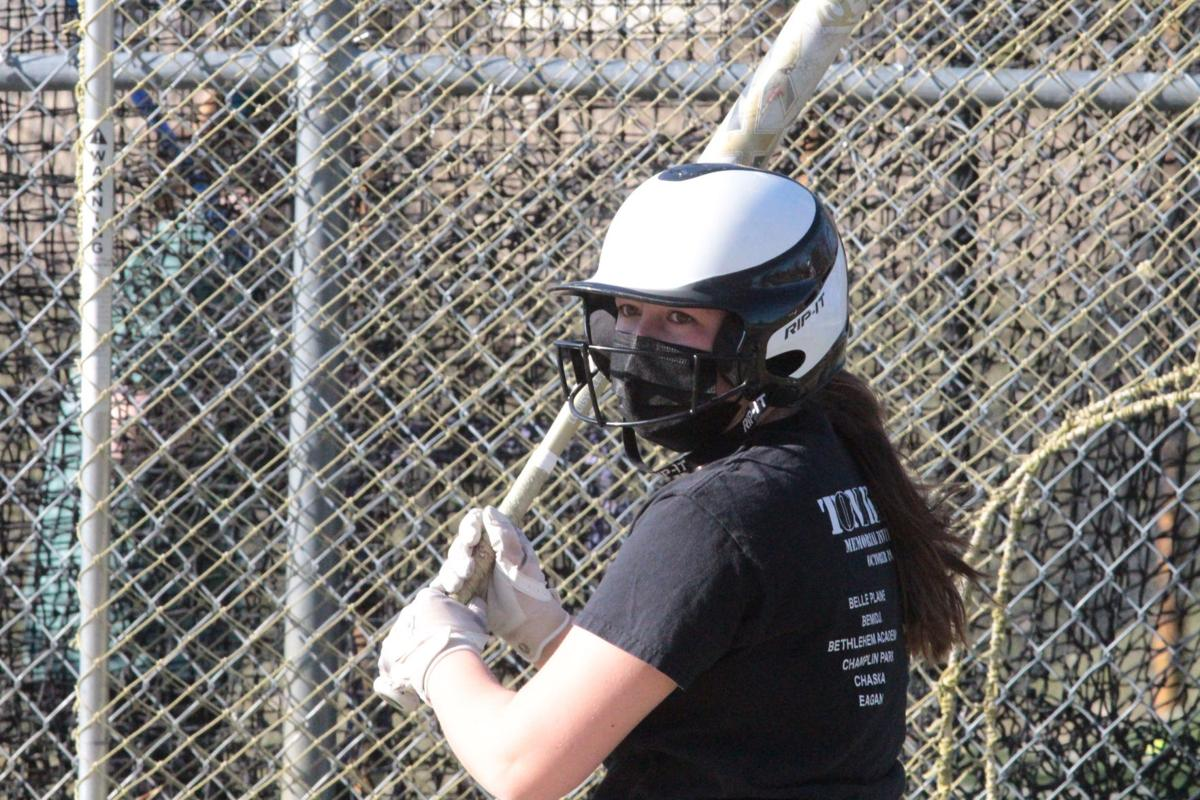 Paige Grafton waits during a hitting drill