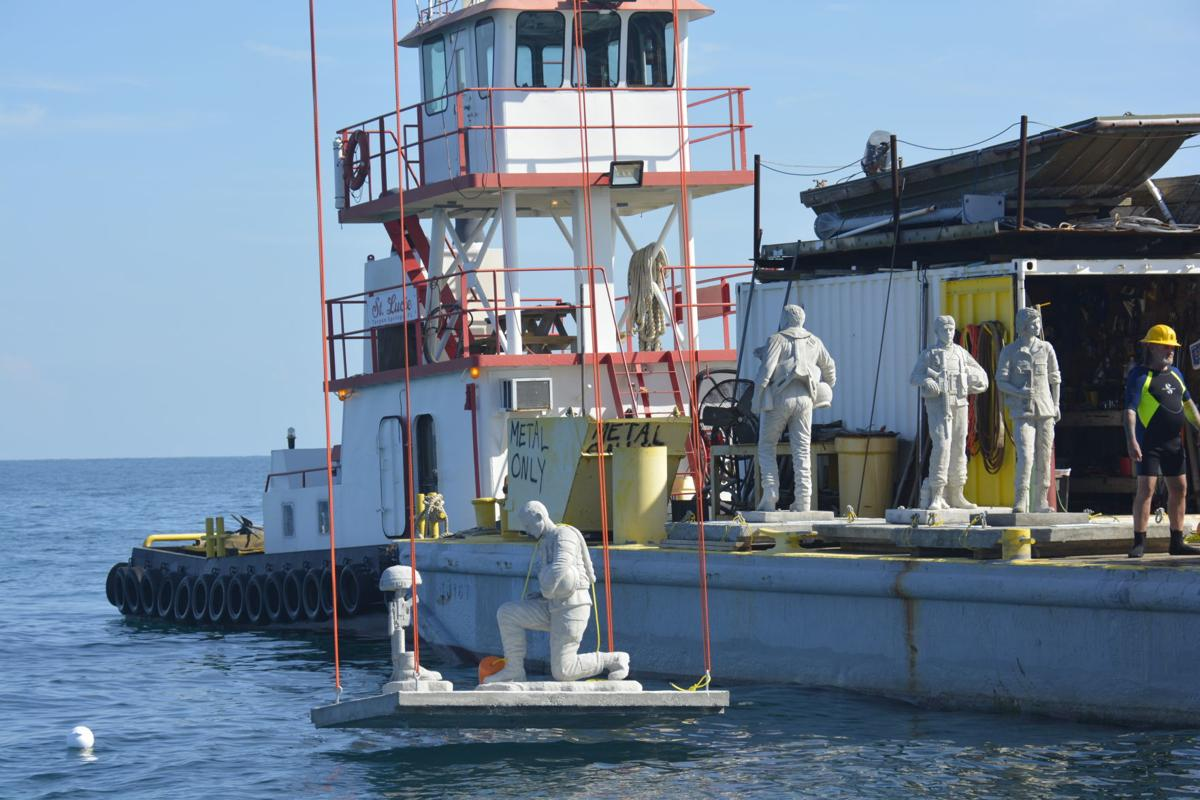 Statues lowered into Gulf of Mexico
