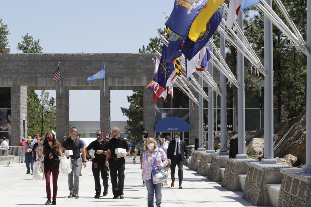 Fireworks attendees enter Mount Rushmore grounds