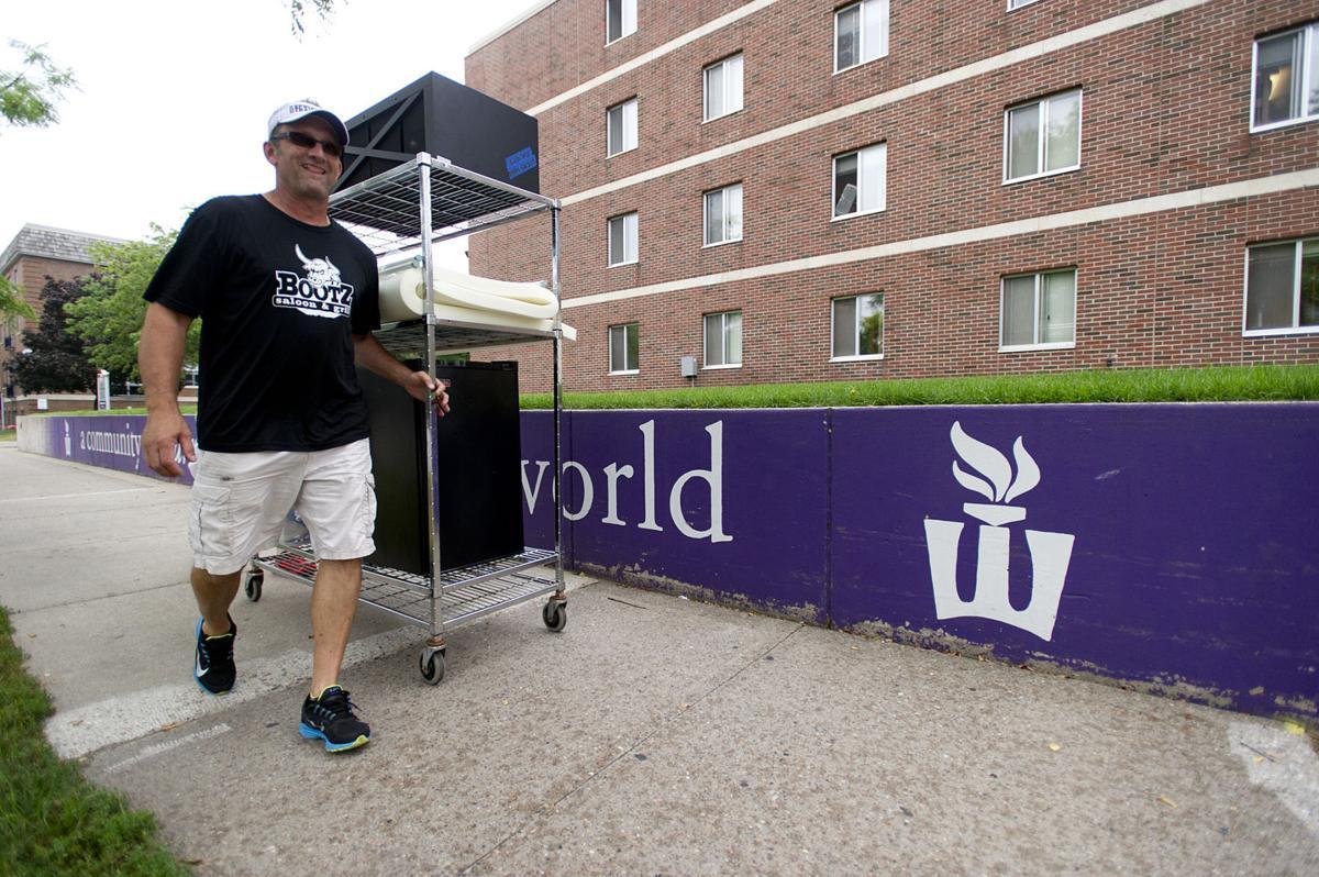 WSU move-in day: New students slog through rain, prepare for