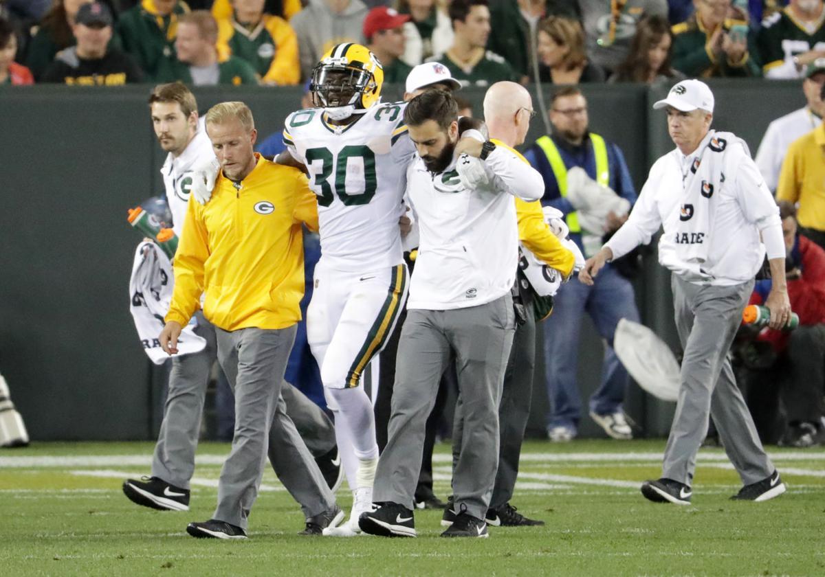 Jamaal Williams hurt, State Journal photo