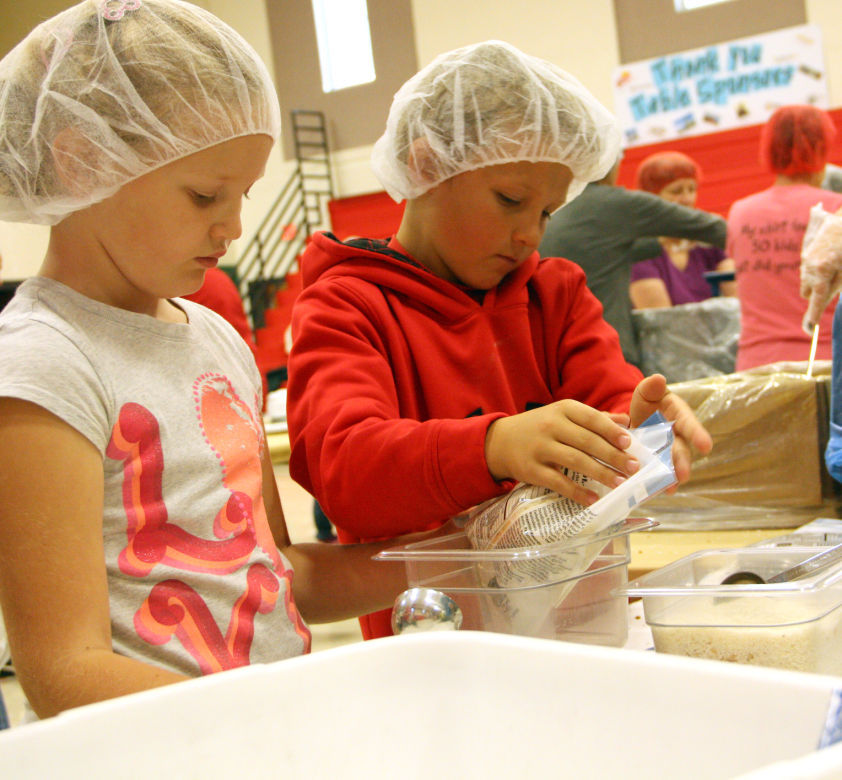 Children help with Feed My Starving Children event