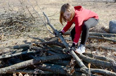 Earth Day weekend volunteers help clear brush from Baraboo wildlife center prairie