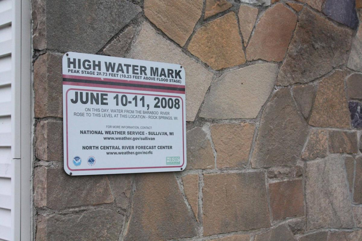 High water mark on side of community center