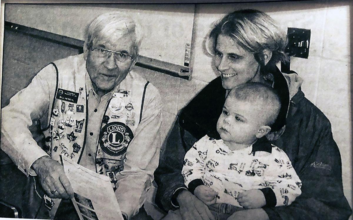2001 Sam Eberhardt, 18 months, and mother Erin with Lion Club member Bill Heimerl.