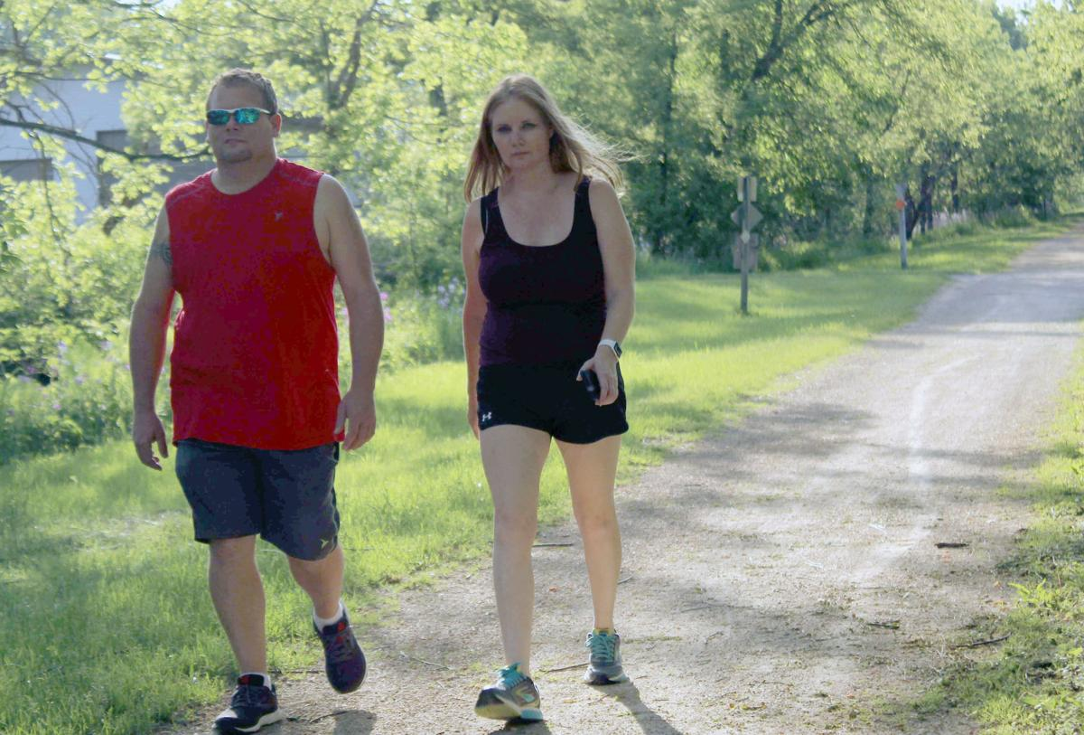 Chad and Carrie walk on 400 State Trail