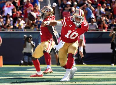 San Francisco 49ers quarterback Jimmy Garoppolo (10) spikes the ball after scoring a touchdown against the Los Angeles Rams on October 13, 2019, at the Los Angeles Memorial Coliseum.