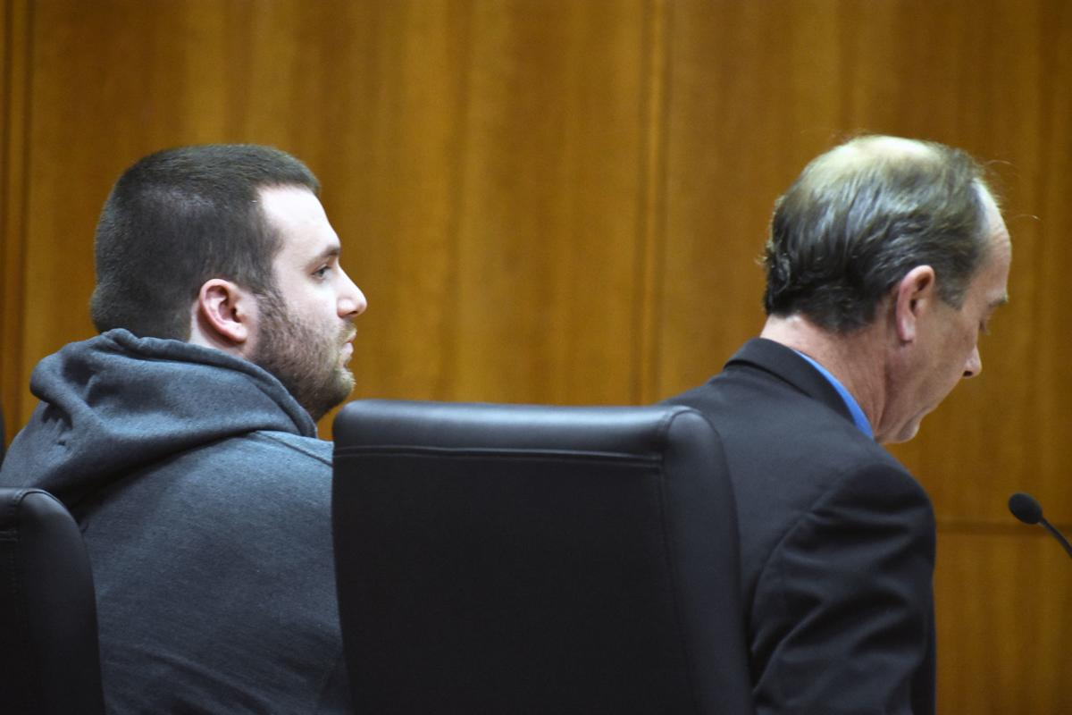 Mitchell Manthey in court with attorney