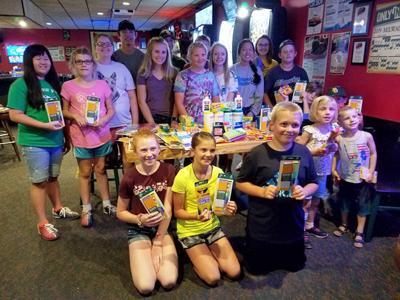 4-H club donates school supplies