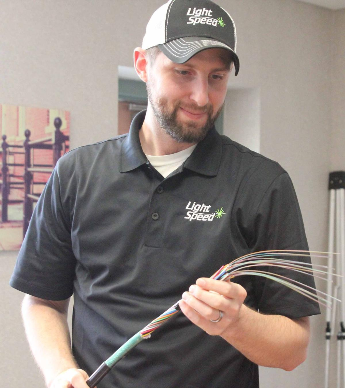 Ken showing fiber optic cable
