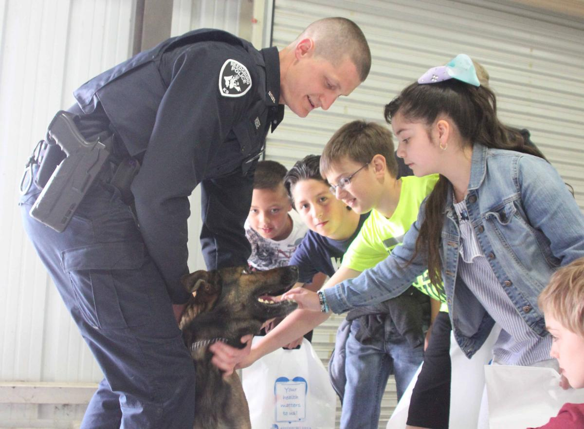 Officer shows K-9 Dog