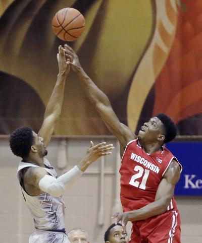 UW MEN'S HOOPS: Badgers rout Hoyas to advance to