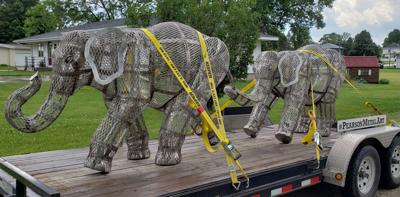 Twin elephant sculptures