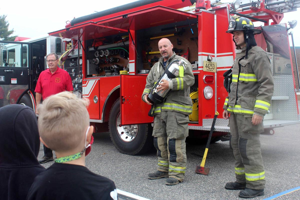 SHOWING FIREFIGHTER EQUIPMENT