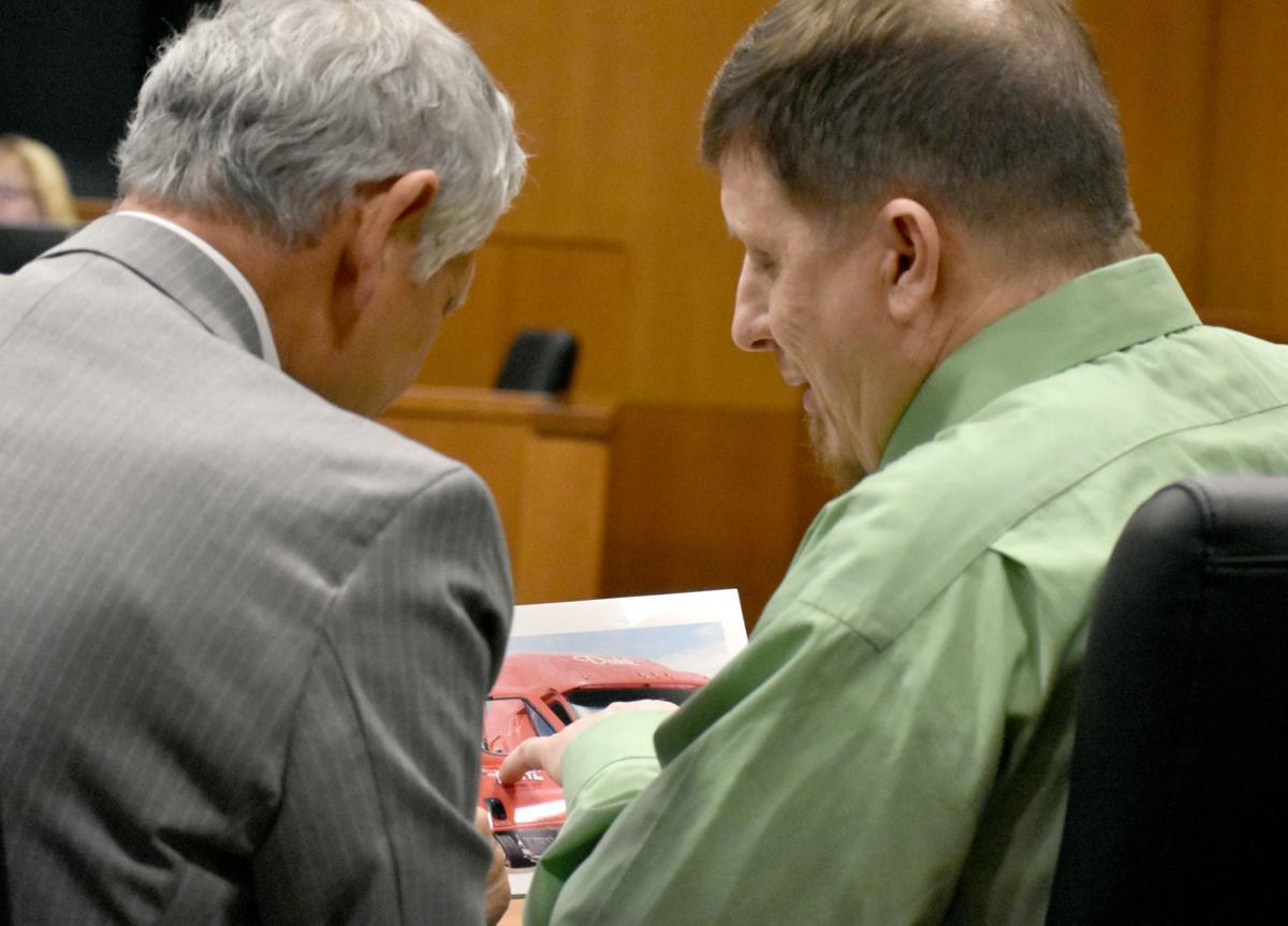 Wayne Murphy shows photo to attorney
