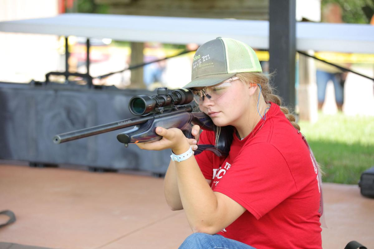 Krista Cook fires rifle