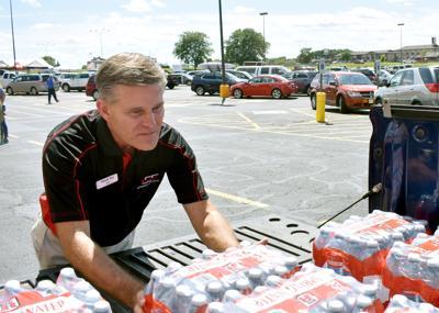 Ken Frey loading water onto truck