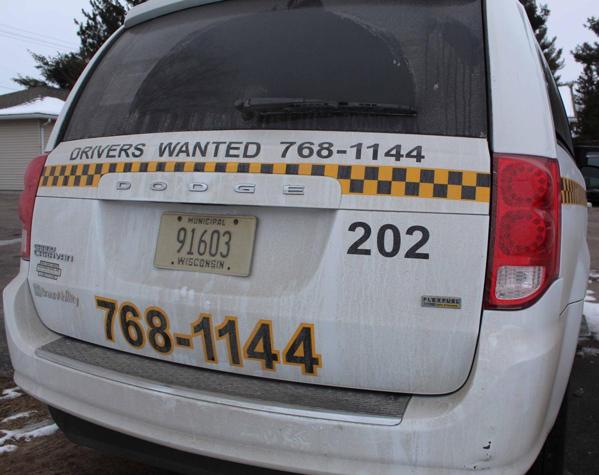 Back of Reedsburg taxi cab