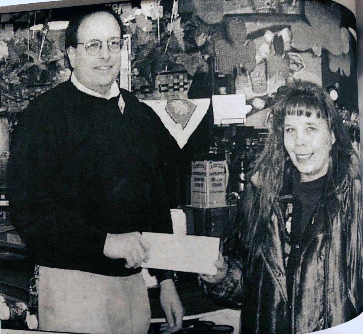 2001 Kwik Trip manager Jeff Blease and Jennifer Harman of Restoration Group.