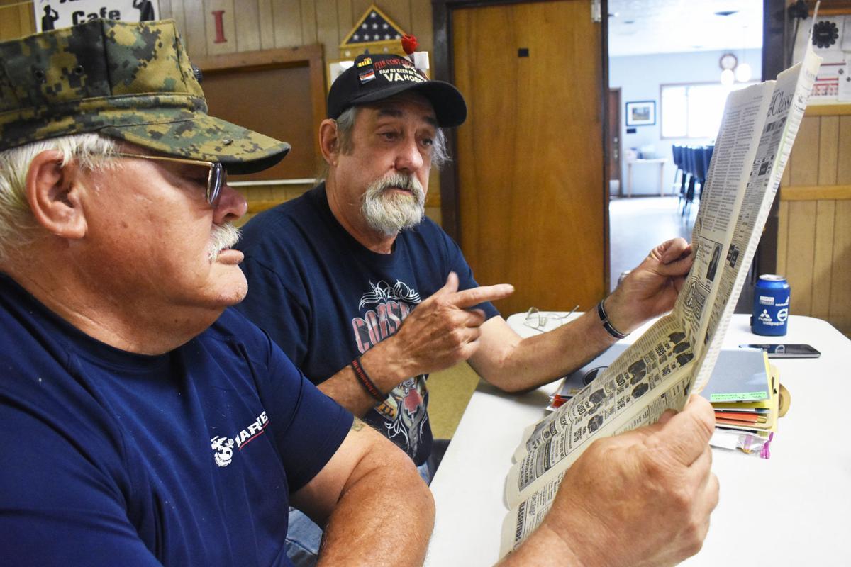 Portage veterans read the newspaper