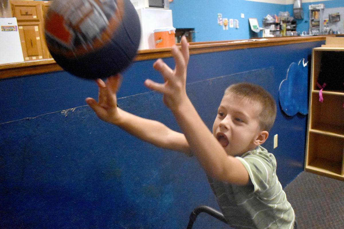 Steven shoots hoops at Baraboo club