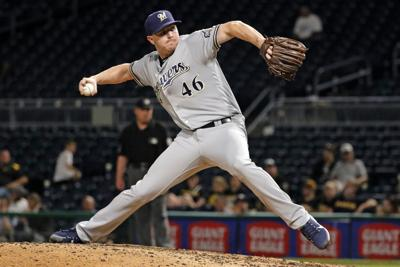 Corey Knebel pitching, AP photo