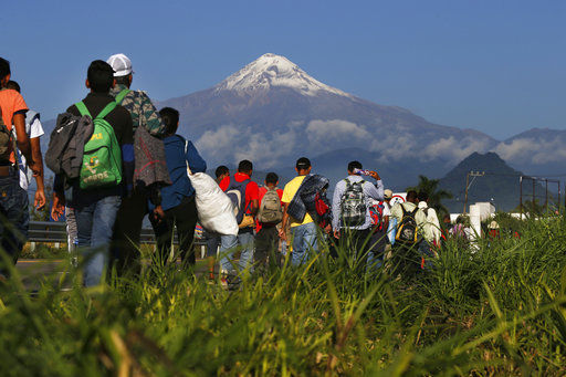 Migrants straggle into Mexico City to shelter at stadium (copy)