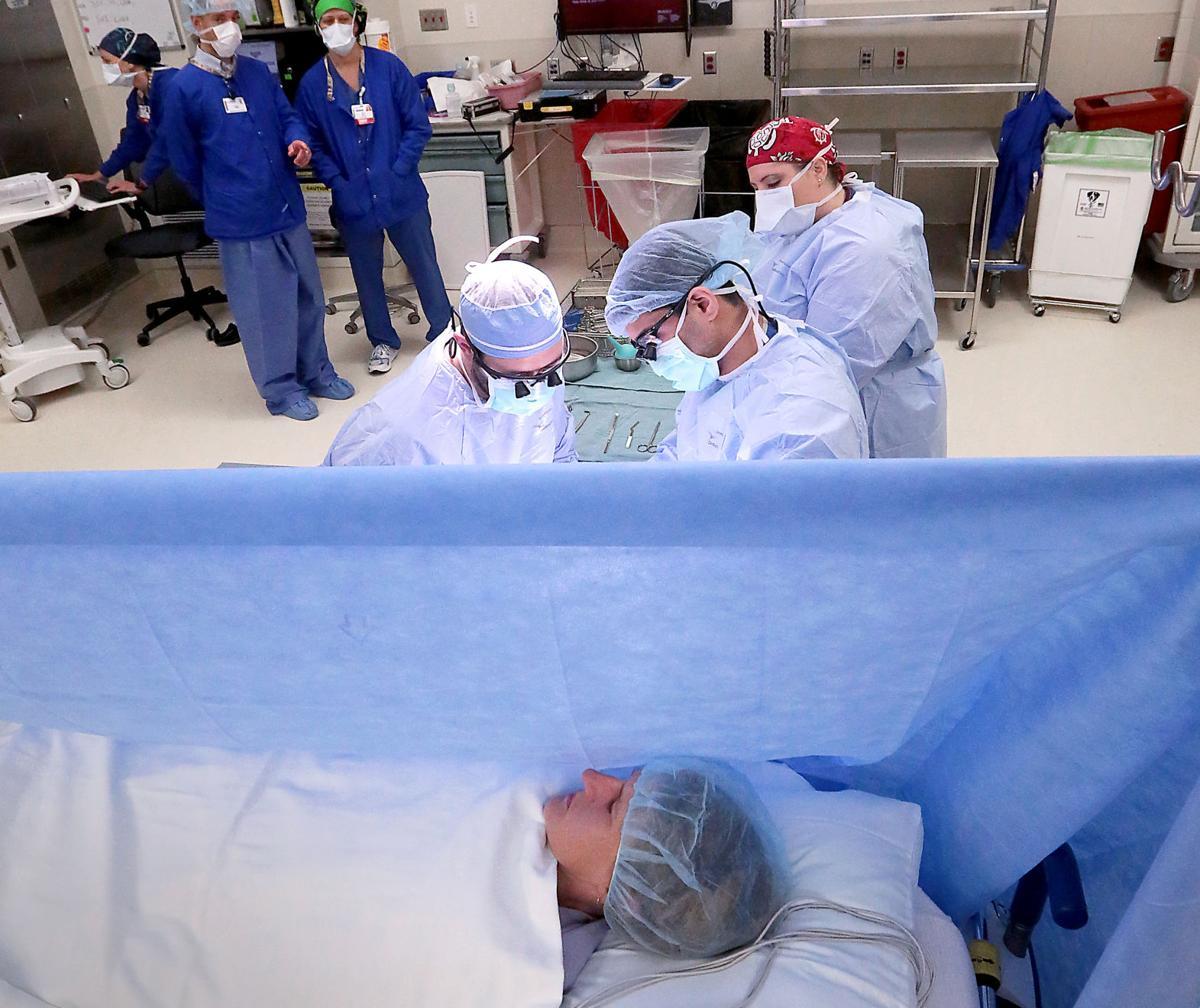Drape between patient and surgeons