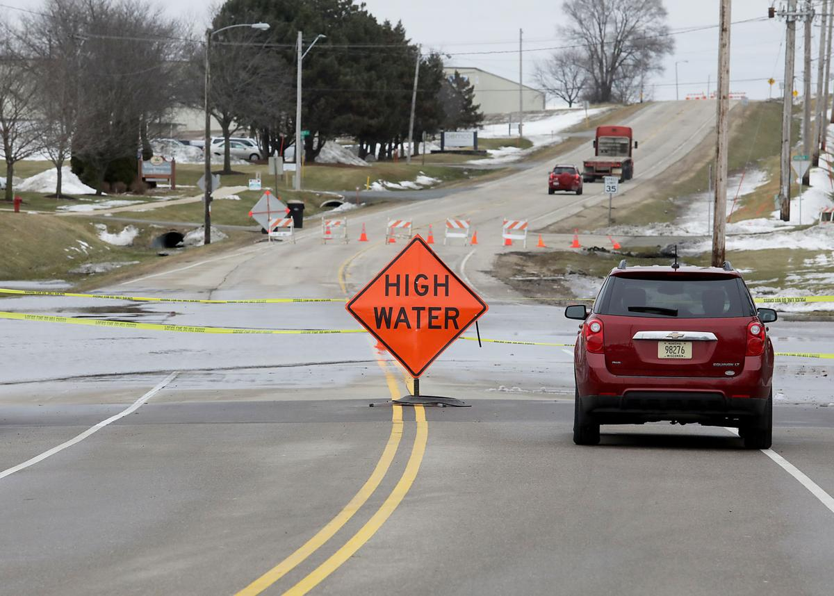 Floodwaters receding, but dozens of roads remain closed in