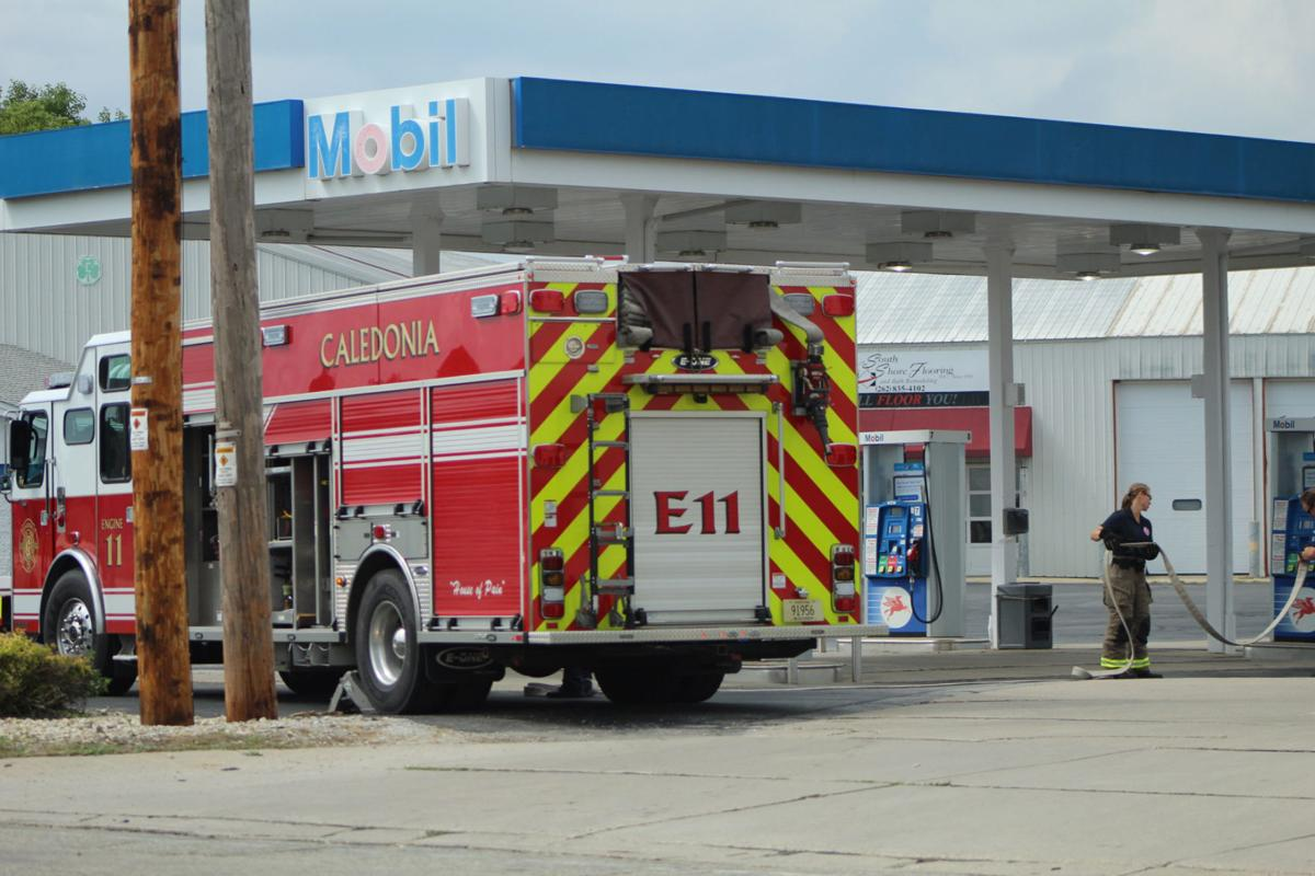 Caledonia Fire Department cleaning up at the Mobil gas station