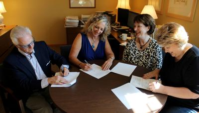 Sign scholarship agreement