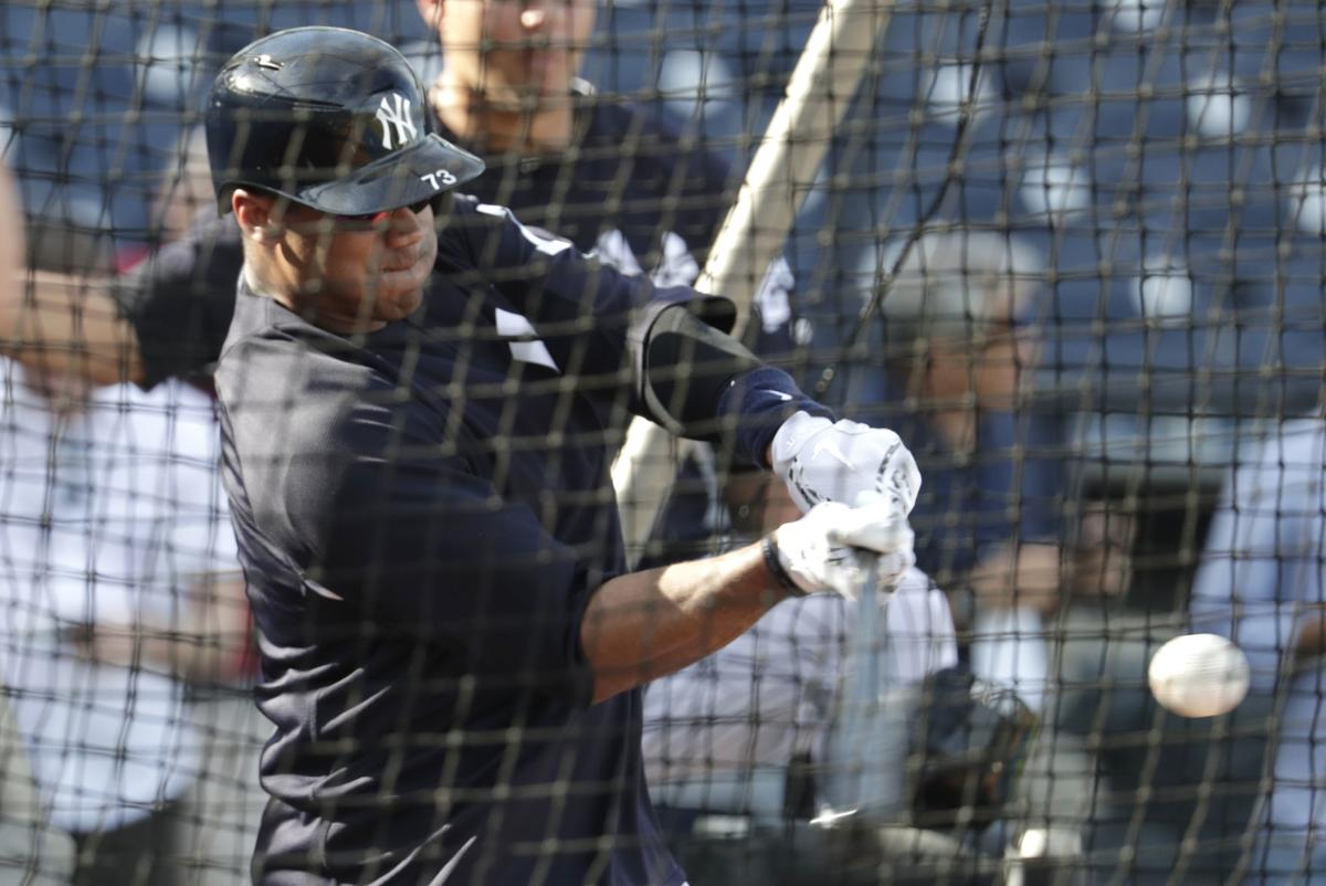 Russell Wilson batting cage 2, AP photo