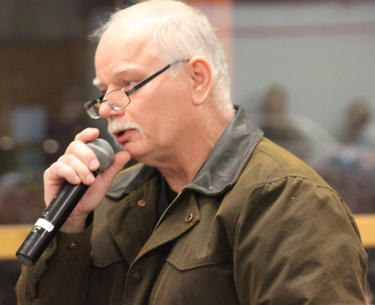 Jim speaks at meeting