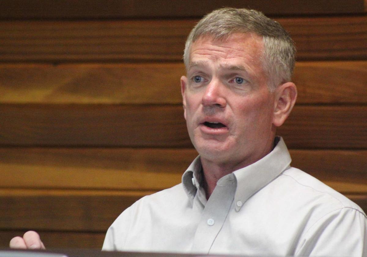Mark speaks at meeting
