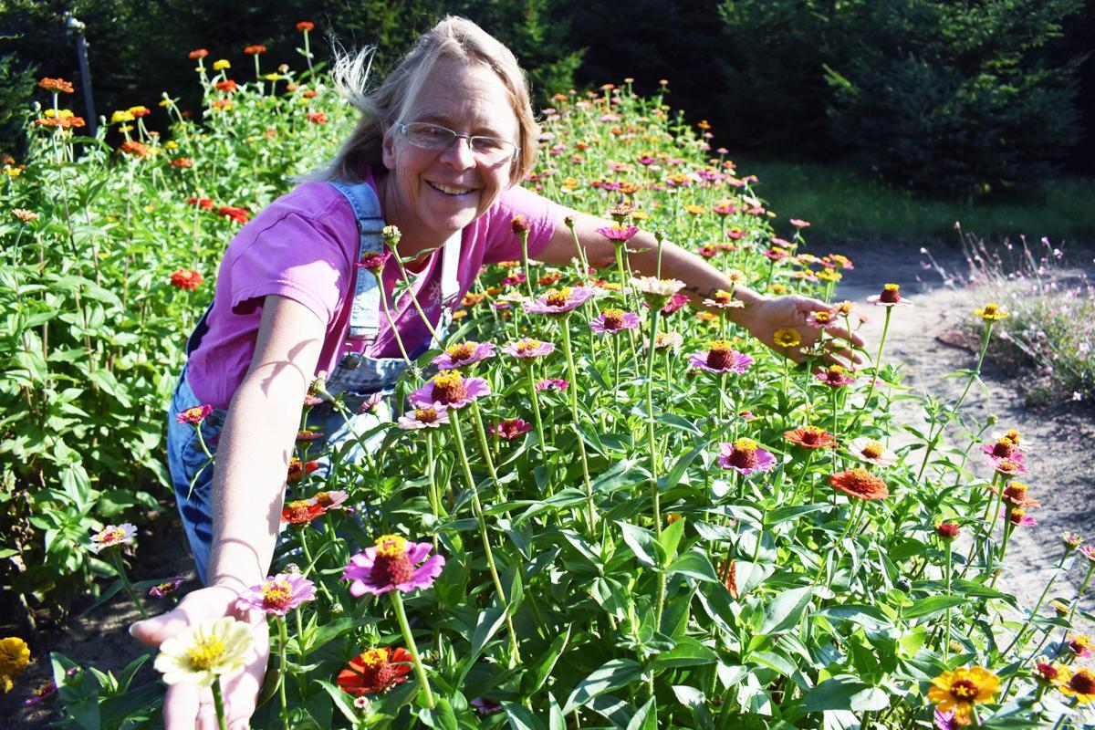 Joanne Alt hugs flowers