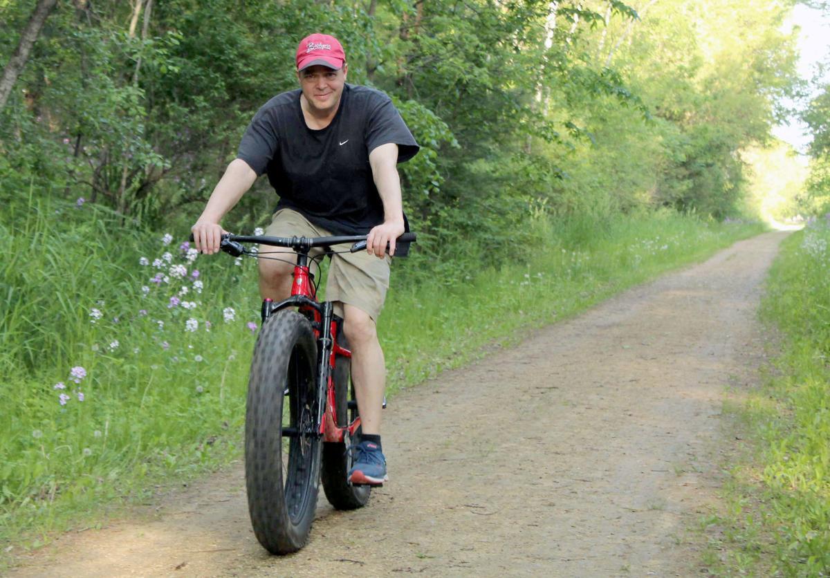 Dan rides bike on 400 State Trail (copy)