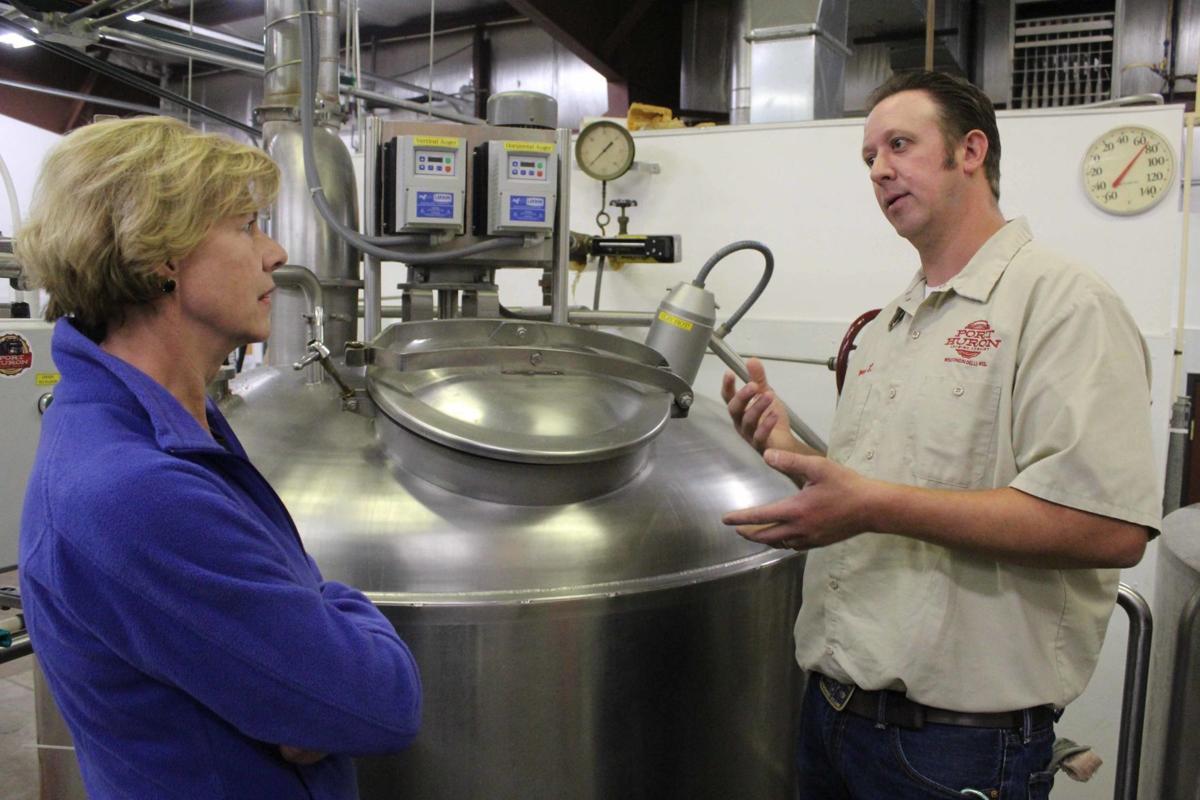 Tanner instruct Tammy on brew (copy)