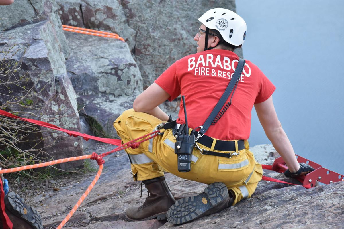 Securing the safety equipment on cliff's edge (copy)